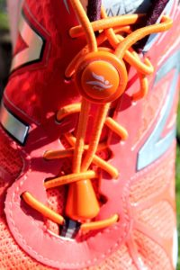 Stopper orange Laufschuh 2